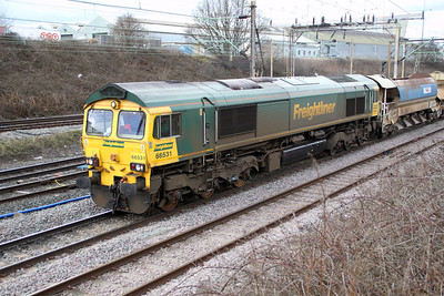 66531 TnT 66553 at 1416 on an engineers passes Crewe Salop into Basford Hall 17/03/12