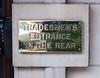Tradesmen's Entrance sign on Florida Ave.