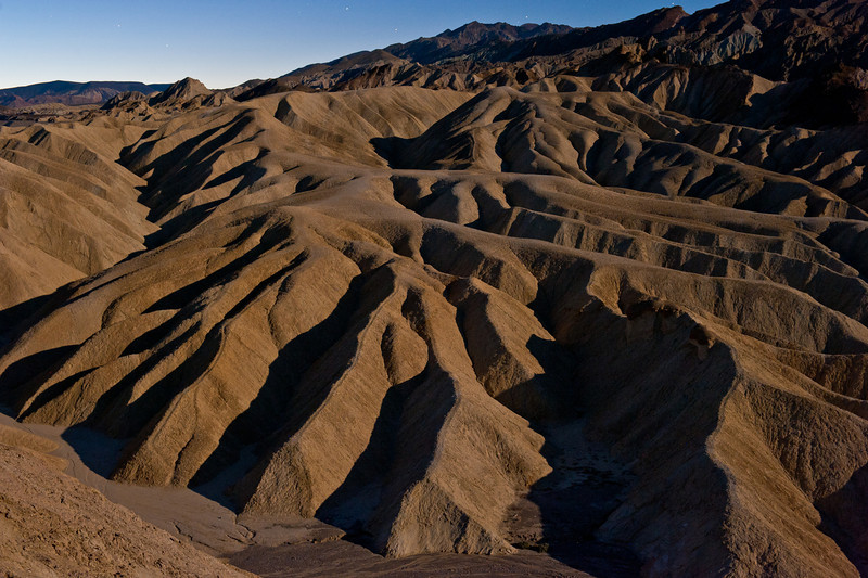 Our first photo event of the trip -- Zabriski Point sunrise. We woke up super early and were the first ones here. It was dark and we weren't sure where exactly we could go without falling over the edge and we initially setup in a very conservative spot. As other photographres showed up we realized we could move around a bit more. I Liked this shot because it showed the shadows of Zabriski Point while under moon light.