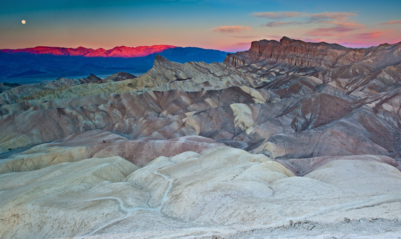 Zabriski Point sunrise, with a touch of color! Loved how I could get teh moon and the alpenglow on the photo