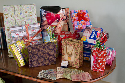"Joshua's one month old ""come to stay"" celebration, brought out many family and friends.  There were lots of gifts and millions in cash!  (2 million dong = $100 USD)"