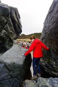 Climbing the rocks at Bandon beach