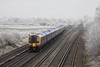 12 December 2012 :: 450002 approaching Worting Junction surrounded by the effects of a dramatic hoar frost especially on the trees in the distance