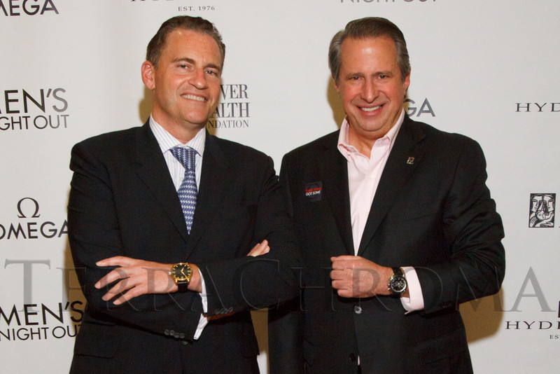 Gregory Swift (Omega president) and Michael Pollak display their watches.  Men's Night Out event, benefiting the Denver Health Foundation, at Hyde Park Jewelers in Denver, Colorado, on Wednesday, Dec. 5, 2012.<br /> Photo Steve Peterson
