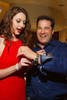 Jewelry model, Elizabeth, helps Aaron LaPedis with his newly-won Omega watch from a raffle.  Men's Night Out event, benefiting the Denver Health Foundation, at Hyde Park Jewelers in Denver, Colorado, on Wednesday, Dec. 5, 2012.<br /> Photo Steve Peterson