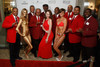 Kappa Alpha Psi fraternity members pose with the Bond Girls.  Men's Night Out event, benefiting the Denver Health Foundation, at Hyde Park Jewelers in Denver, Colorado, on Wednesday, Dec. 5, 2012.<br /> Photo Steve Peterson