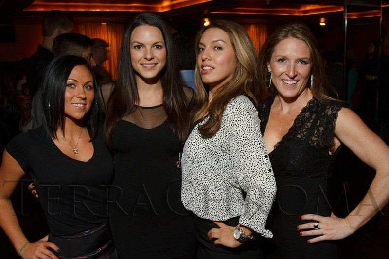 """Michelle Daw (cq), Tara Hallam, Jessica Jimenez, and Jennifer Klein.  """"Miracle on Fifth Avenue,"""" the 4th annual holiday party benefiting youth charities, hosted by Madison Carter, at Cherry in Denver, Colorado, on Wednesday, Dec. 5, 2012.<br /> Photo Steve Peterson"""