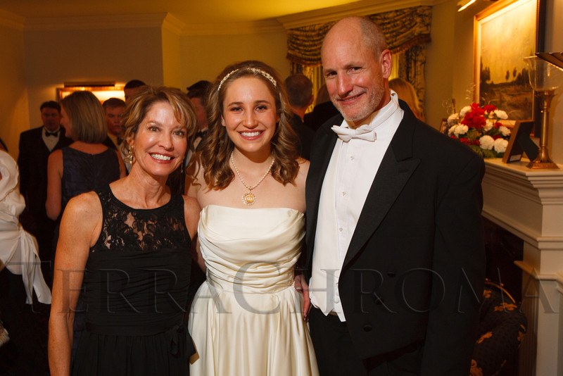 Maggie DeLine with her parents, Becky and Dr. Jim DeLine.  The 2012 Denver Debutante Ball, benefiting the Denver Botanic Gardens, at the Brown Palace Hotel and Spa in Denver, Colorado, on Saturday, Dec. 22, 2012.<br /> Photo Steve Peterson