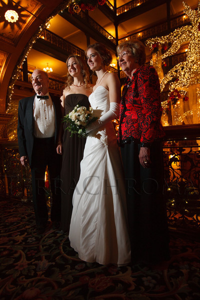 Debutante Jennifer Clinton with her sister, Emily (2nd from left) and grandparents, xxx and Jane xxx.  The 2012 Denver Debutante Ball, benefiting the Denver Botanic Gardens, at the Brown Palace Hotel and Spa in Denver, Colorado, on Saturday, Dec. 22, 2012.<br /> Photo Steve Peterson