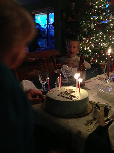 Connor helps Grandma blow out her birthday candles.