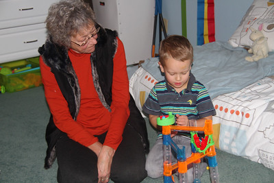 Sharing his new marble run with Aunt Nunan