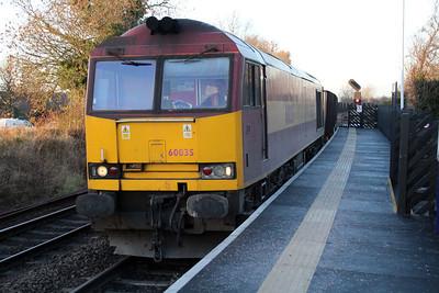 60035 1516/6t26 Immingham-Santon iron ore train passes Ucelby Station.