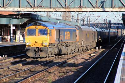 66715 0930/6f12 Tyne Dock-Cottam passes Doncaster Station.