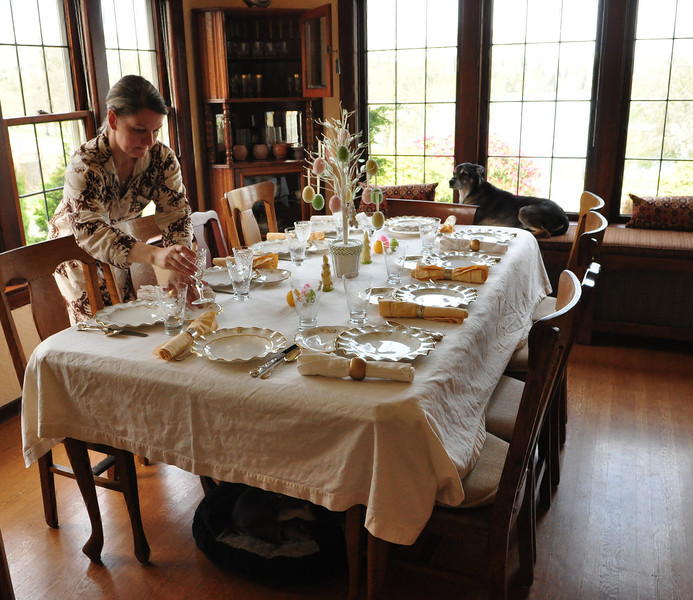 Setting the table in her jammies. Note both dogs in the photo -- they like to be present for all stages of a big meal.