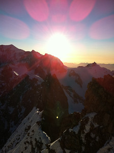 Setting sun with Mont Blanc on the left and Aiguille du Midi on the right.