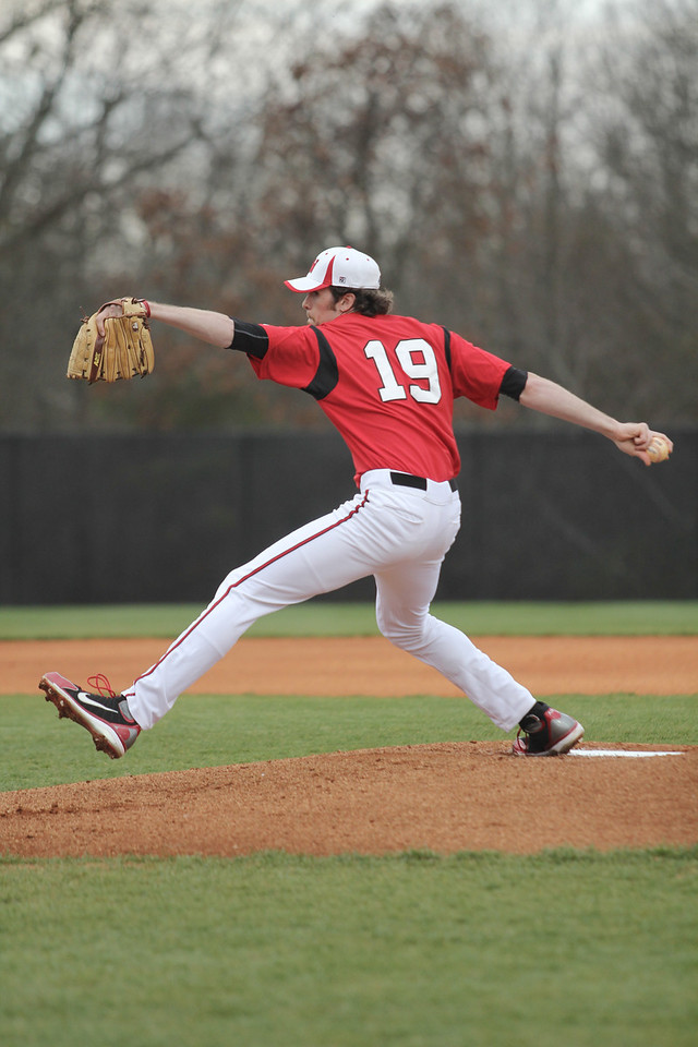 Number 19, Brock Wilson pitches the ball