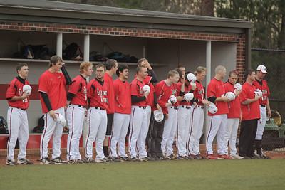 The Runnin' Bulldogs line up on the sidelines for the National Anthem
