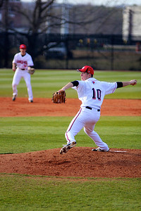 Pitcher, Andrew Barnett, throws a ball