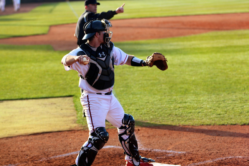 Catcher, John Harris, throws the ball