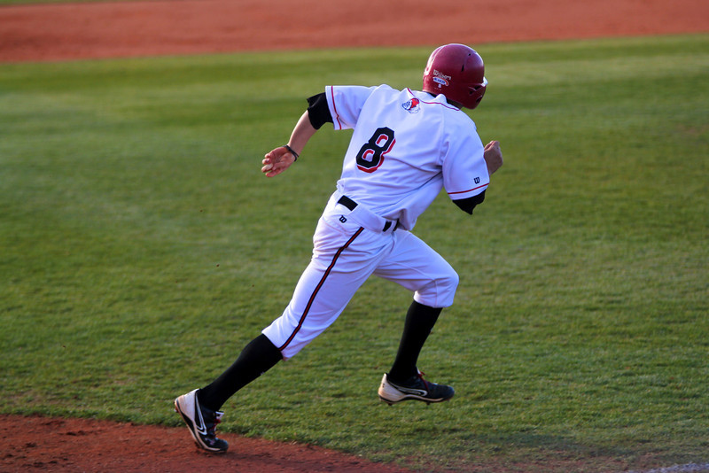 No. 8, Ryan Allen, runs to first base
