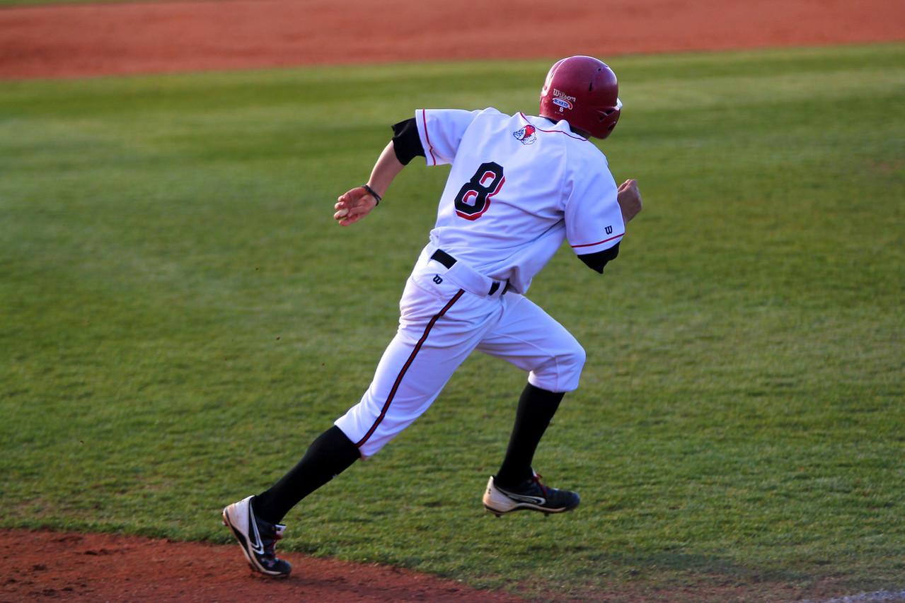 No. 8, Ryan Allen, runs to first base