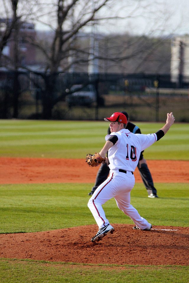 Pitcher, Andrew Barnett, throws the ball