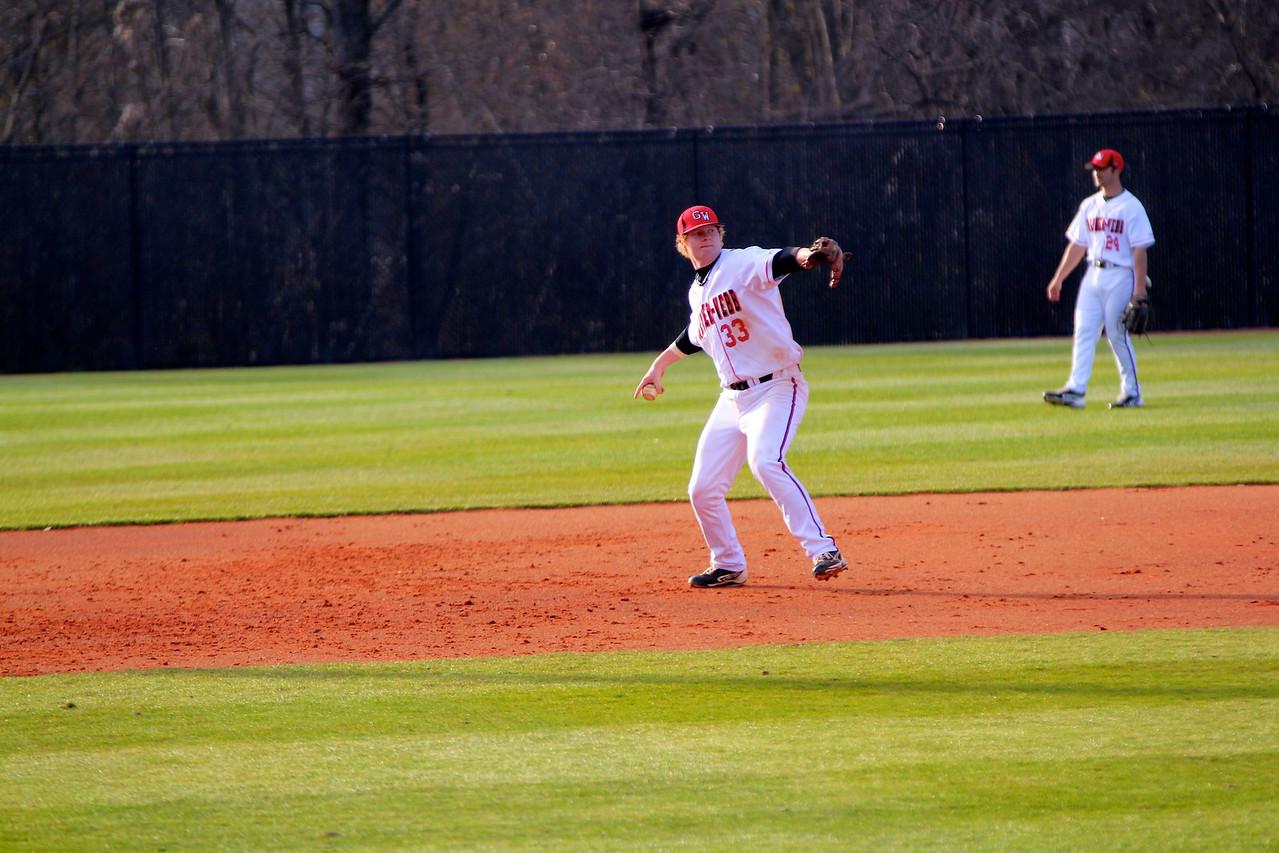 Third Baseman, Brad Collins, throws the ball