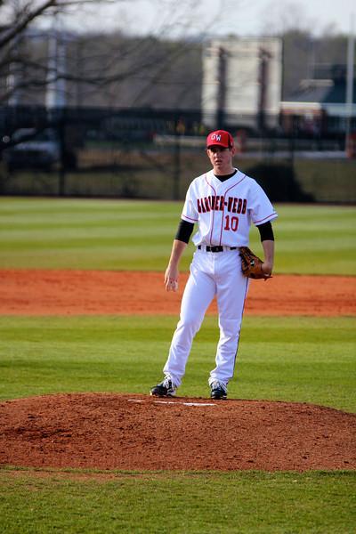 Pitcher, Andrew Barnett, studies the call