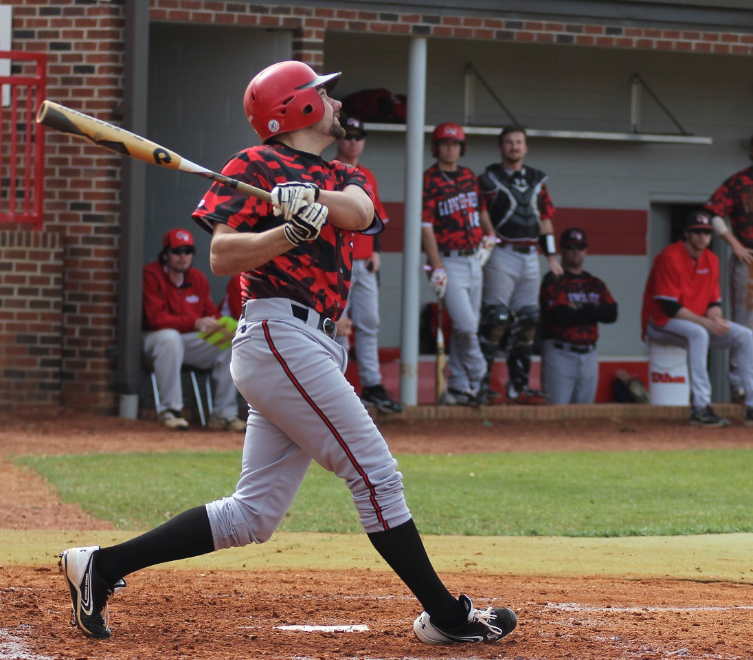 Number 21, Adam McFarland, hits the ball.