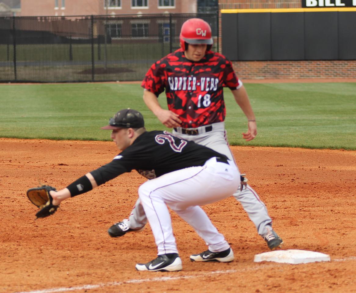 Number 18, Scott Coleman, hustling to get back to first base.
