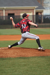 Number 30, Beau Hilton, pitching the ball.