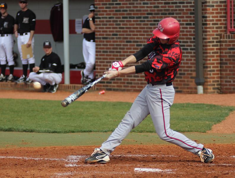 Number 6, Ryan Hodge, swinging the bat.