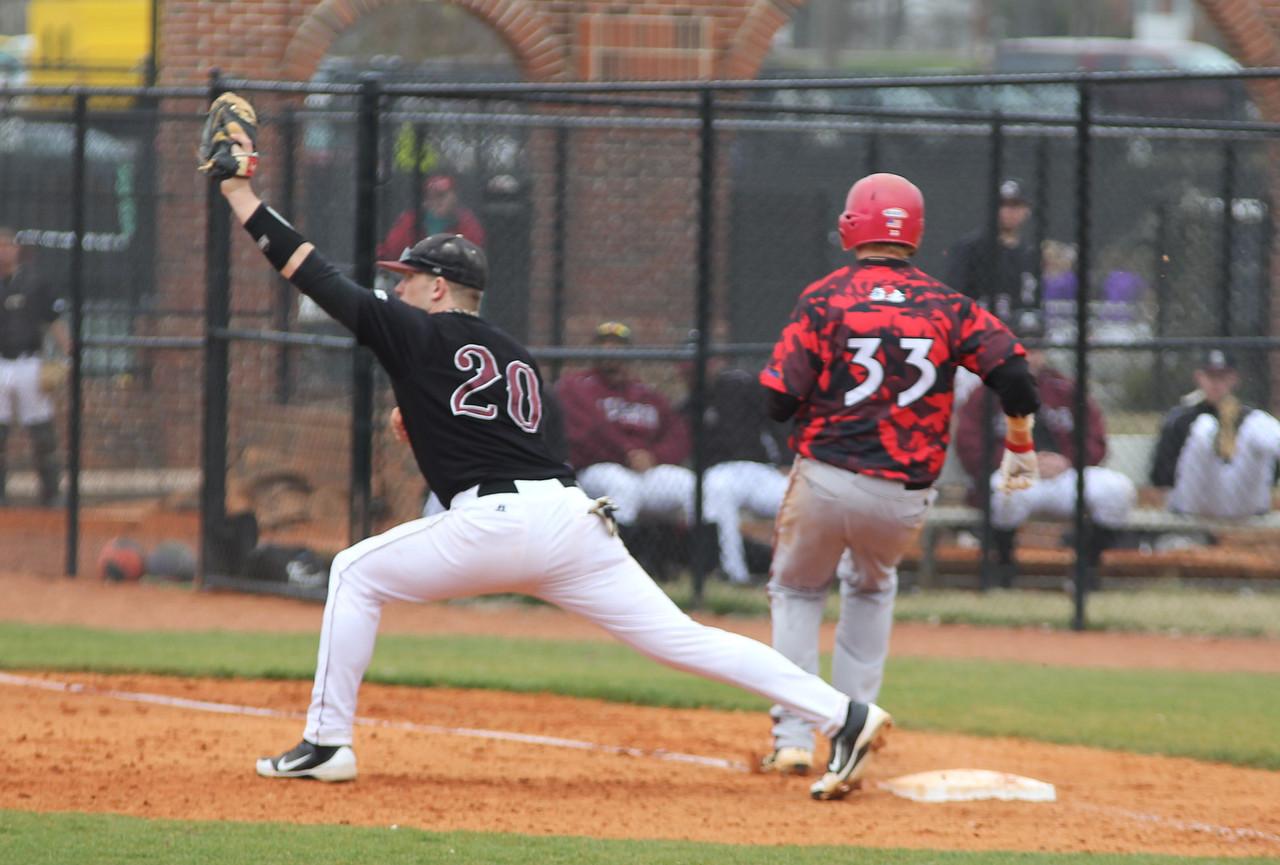 Number 33, Brad Collins, safe at first base.