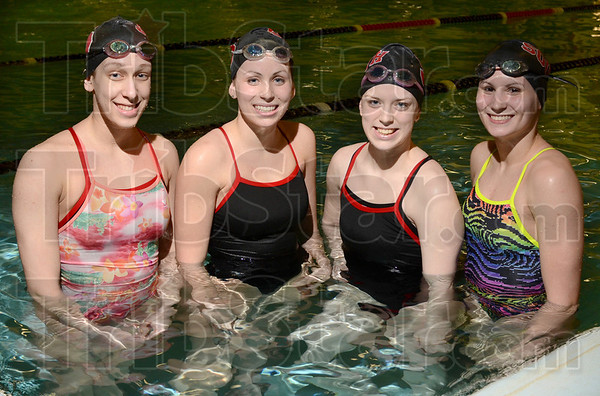 Tribune-Star/Joseph C. Garza<br /> State-bound: Terre Haute South swimmers Grace Padget, Sarah Senseman, Mercedez Bray and Katherine Senseman will compete at the state level for the Braves.