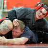 Tribune-Star/Jim Avelis<br /> Partners: Tsali Lough wrestles against former teammate P.J. Montgomery late Monday afternoon in the Terre Haute South wrestling room. Montgomery is helping Lough prepare for his Friday night match in Indianapolis in the state wrestling finals.