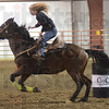 Tribune-Star/Jim Avelis<br /> Riding high: Cindy Harlan rounds the first barrel as she takes part in the jackpot race Wednesday night at her C Bar C Expo Center in Cloverdale.