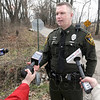 Media man: Conservation officer Max Winchell talks with news media at the entrance to the Prairie Grove Hunting Preserve in Clay County Thursday afternoon.