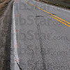 Tribune-Star/Jim Avelis<br /> Reminders: Gouges from trucks sliding on their sides mar the pavement of Indiana 159 east of Blackhawk. The shoulders of the curve bear witness to many vehicles trying to take the corner too fast.