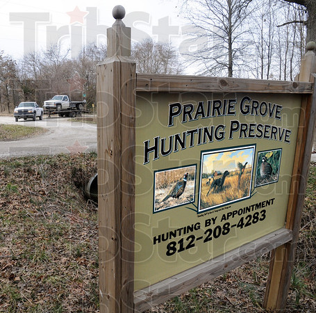 Seized: A DNR vehicle tows a vehicle from the Praire Grove Hunting Preserve Thursday afternoon after Conservation police announced the arrests of two men for various violations.