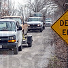 Convoy: A convoy of Department of Natural Resources remove several vehicles from the Prairie Grove Hunting Preserve in Clay County Thursday afternoon.
