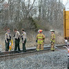 Tribune-Star/Jim Avelis<br /> Fatal scene: Illinois emergency personnel work at the scene of a fatal car-train accident Wednesday afternoon in eastern Clark County. Two adults were killed and three children were sent to the hospital in the crash.