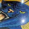 PANTHER: Detail of Center court mascot at the Riverton Parke Gym.