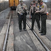 Tribune-Star/Jim Avelis<br /> Notes: Illinois law enforcment officials compare notes as they finish their work at the scene of a fatal car-train accident Wednesday in Clark county Illinois.