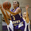 Tribune-Star/Jim Avelis<br /> In and up: Caelan Jones splits the Clay City defense for two points.