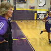 Been there: Julie Meeks watches her Sullivan High School girls basketball team finish practice with wind sprints Tuesday afternoon.