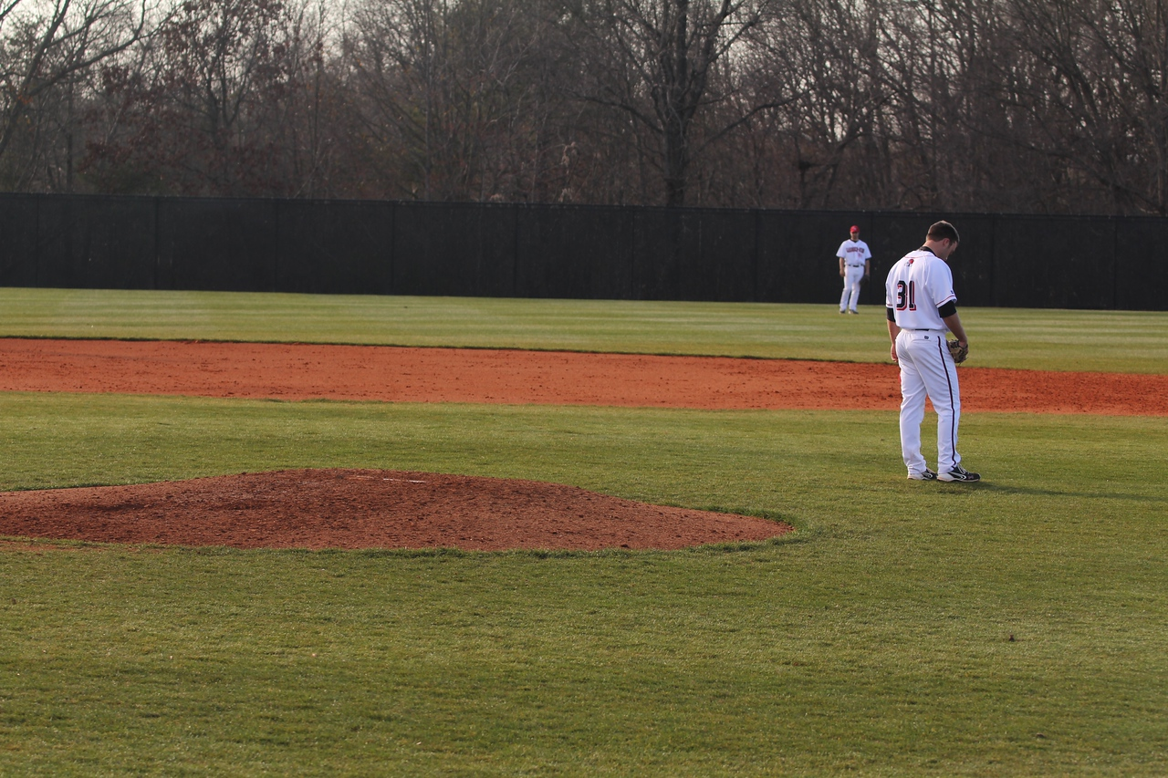 Player 31, Will Canady, prays before pitching.