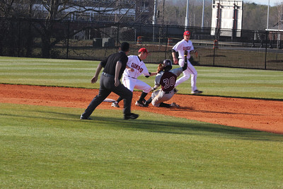 Gardner-Webb works together to get the other team out when trying to steal bases.
