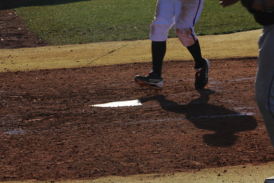 Player runs to home, making it across the plate safely.