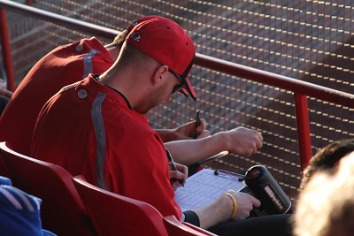 watching the speed of the pitch, these gwu men write down the results while during the game.
