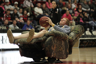 Brad Collins, a Gardner-Webb baseball player, attempts a free throw shot to win the camouflage chair he has to shoot from.